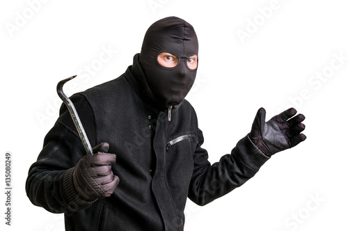 Fotografía  Masked thief in balaclava with crowbar isolated on white
