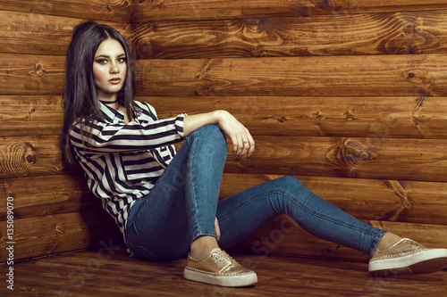 Portrait Of Young Beautiful Dark-haired Model Wearing
