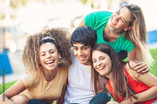 Poster  Group of happy teenagers in the park