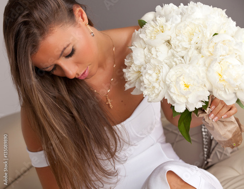 Fotografie, Obraz  Beautiful woman with bouquet of white peonies.