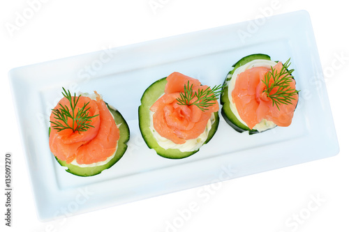 Poster Entree Canapes with smoked salmon, cream cheese and cucumber isolated, overhead view