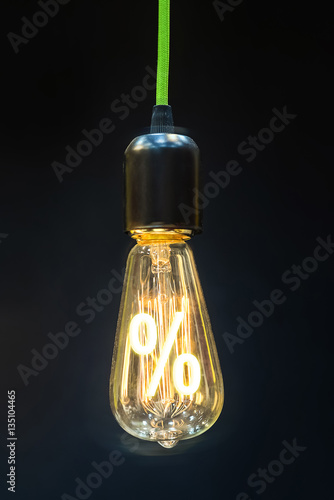 Papiers peints Retro Bulb with glowing percent mark inside of it, creativity concept