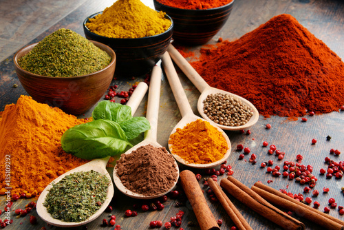 Variety of spices on kitchen table Canvas Print