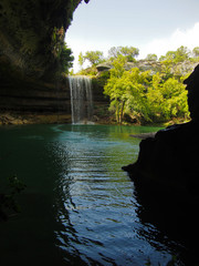 A waterfall at a limestone rock formation at Hamilton Pool Preserve near Austin, Texas.