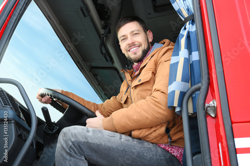 Fotografía  Driver in cabin of big modern truck