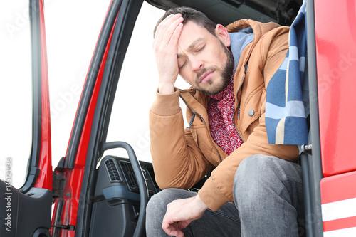 Foto  Driver in cabin of big modern truck