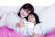 Beautiful mother and child take selfie photo