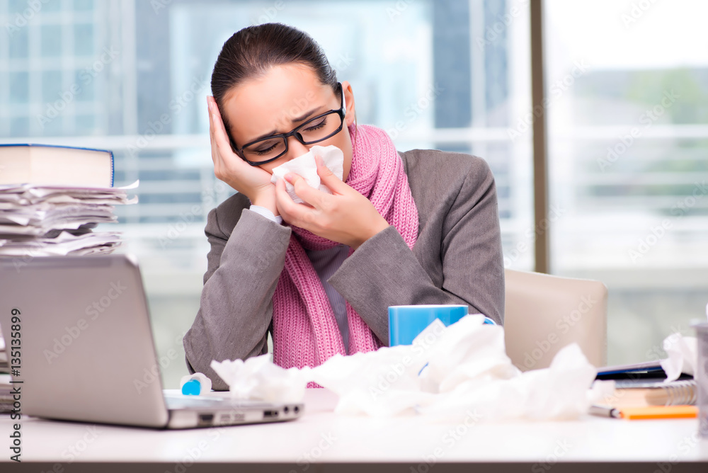 Fototapeta Young businesswoman sick in the office