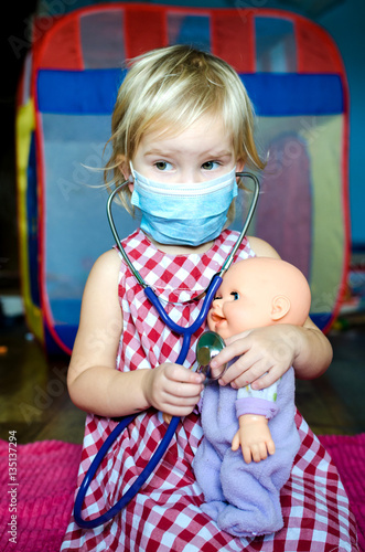 A Playing Girl Child Little Her Doctor With Doll Dressed In