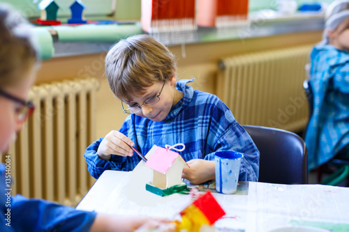 Stupendous Little School Kid Boy With Glasses Coloring Bird House With Download Free Architecture Designs Scobabritishbridgeorg