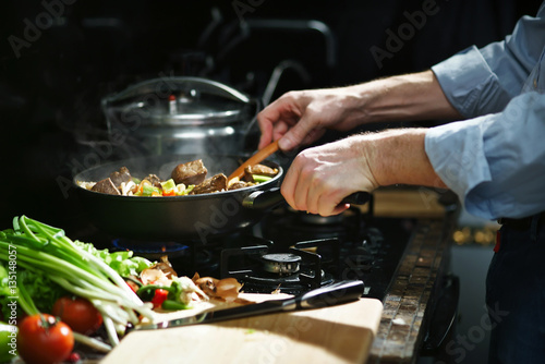 Fotobehang Koken Cooking meat with a vegetables