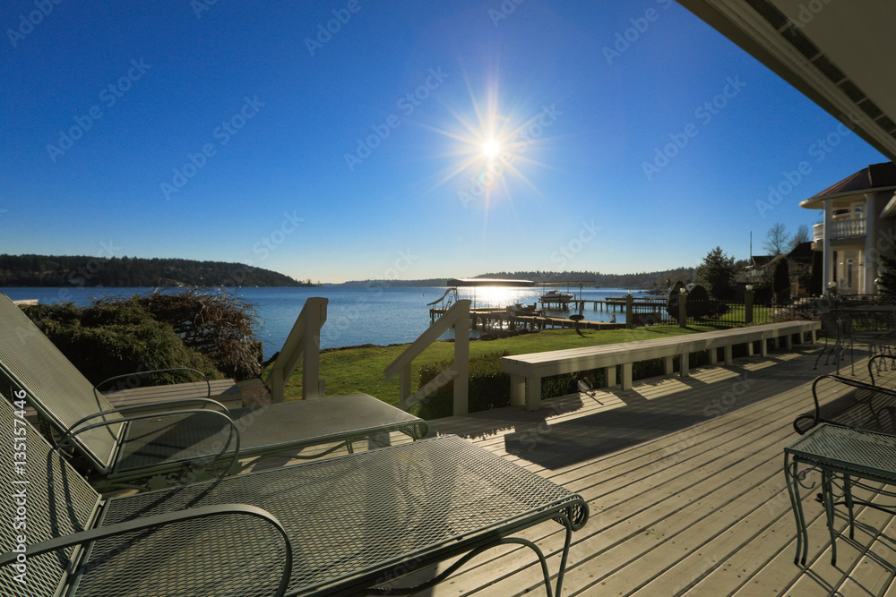 Fototapety, obrazy: Large spacious deck of grey waterfront home at sunset