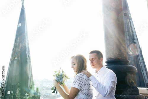 Foto op Aluminium Kuala Lumpur Sun shines bright over dreamlike wedding couple standing on the