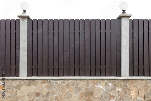 Fotografie, Obraz  New wooden fence with concrete pillars equipped with street lights on a stone fo