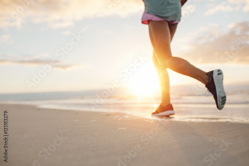 Foto op Canvas Jogging Feet of young woman jogging on the beach