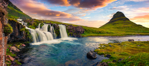 Cascades Summer sunset on famous Kirkjufellsfoss Waterfall and Kirkjufell