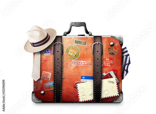 Photo Retro suitcase of a traveler with travel stickers