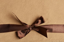 Brown Ribbon On Yellow Background