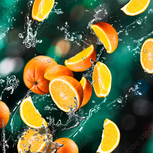 Orange fruits and Splashing water