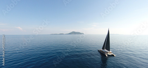 Photo Stands Ocean Amazing view to Yacht sailing in open sea at windy day. Drone view - birds eye angle. - Boost up color Processing.