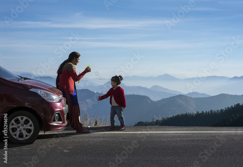 Fotografia, Obraz  Mother and daughter enjoying the road trip and winter vacation