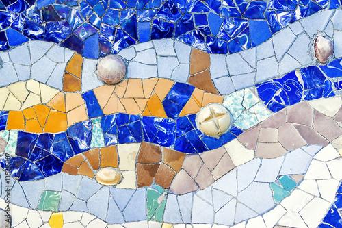 Photo  Closeup of mosaic of colored ceramic tile by Antoni Gaudi at his