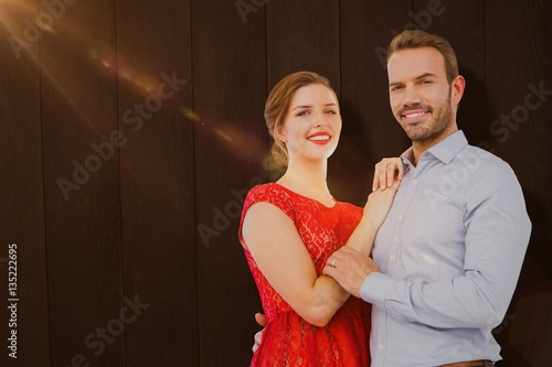 Photographie  Composite image of portrait of young couple embracing each other