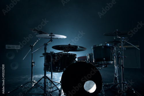 Fotografía  Modern drum set shot in smoky dark studio