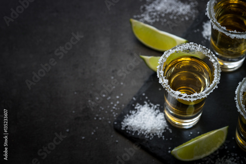Fototapeta Tequila shot with lime and sea salt
