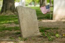Old Worn Gravestones With Fres...