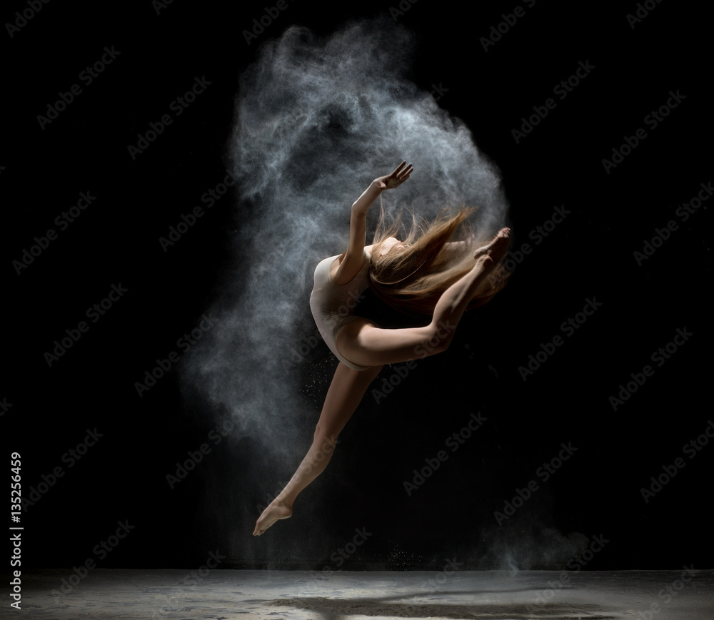 Fototapeta Graceful girl dancing in white dust powder