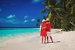 happy loving couple walking on beach