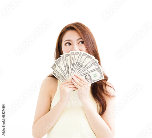 Valokuva  happy young  woman showing the money