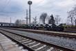 Burgas, Bulgaria - January 24, 2017 - Freight cargo train - black cars wagons - New 6-axled flat wagon - Type: Sahmmn - Model WW 604 A - Transvagon AD