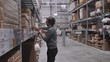 worker moving, taking out, putting, segregating, lifting on from shelves in warehouse. Man with box in modern stock