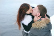 Winter love story. Young couple engagement outdoors.