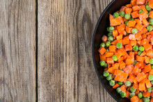 Frozen Peas And Carrots For Cooking On A Pan