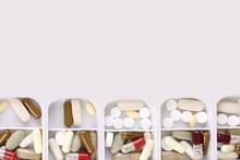 Medicine Dose Box. Prescription Pills And Vitamins In A Pill Box.Isolated.