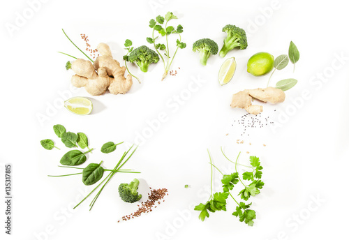Fotografía  Green salad ingredients on white background