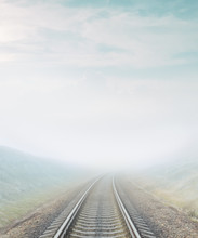 Railroad Goes To Horizon In Fog