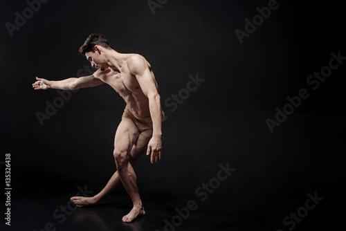 Flexile ballet dancer performing in the studio Poster Mural XXL