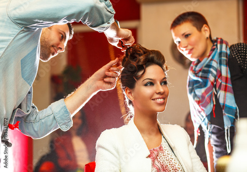 Young woman gets new hairstyle at the hairdresser.Beauty salon.