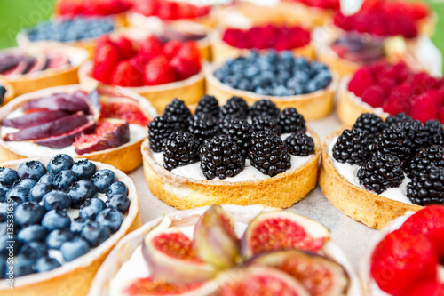 Photo Stands Dessert Closeup of blackberry tart dessert tray assorted
