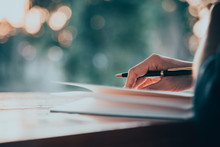 Close Up Women Hand On Writing...
