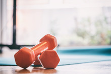 Pair Of Dumbbells On A Wooden ...