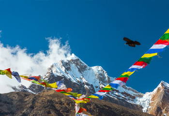 Majestic Mountain View with Buddhist Prayer Flags and Bird