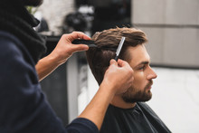 Male Client Getting Haircut By...