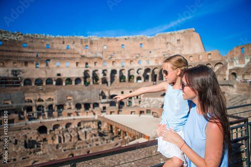Fotografia, Obraz  Family exploring Coliseum inside in Rome, Italy
