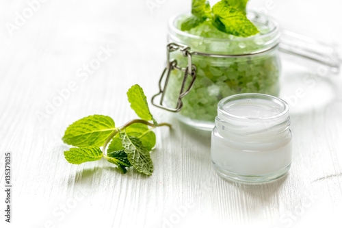 Fotografie, Obraz  organic cosmetics with herbal extracts of mint on wooden background