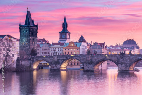 Charles Bridge in Prague with sunset sky in background, Czech Republic.